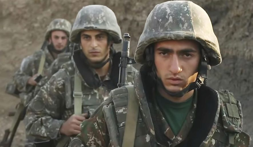 """In this image taken from video released by the Armenian Defense Ministry on Wednesday, Sept. 30, 2020, Armenian solders guard their position in the self-proclaimed Republic of Nagorno-Karabakh, Azerbaijan. Armenia's Foreign Ministry in a statement """"completely"""" denied reports of shelling the Dashkesan region and said that with those reports Azerbaijan was laying the groundwork for """"expanding the geography of hostilities, including the aggression against the Republic of Armenia."""" (Armenian Defense Ministry via AP)"""