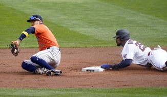 Minnesota Twins' Byron Buxton, right, steals second base as Houston Astros shortstop Carlos Correa takes the throw in the first inning of an American League wild-card series baseball game Tuesday, Sept 29, 2020, in Minneapolis. (AP Photo/Jim Mone)