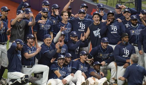 The Tampa Bay Rays celebrate after eliminating the Toronto Blue Jays during Game 2 of an American League wild-card baseball series Wednesday, Sept. 30, 2020, in St. Petersburg, Fla. (AP Photo/Chris O'Meara)