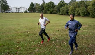 CORRECTS NAME OF ATHLETE   Ethiopia's Kenenisa Bekele, right, trains alongside his coach Peter Eemers within the grounds of the official hotel and biosecure bubble in London, Wednesday Sept. 30, 2020, ahead of the elite-only 2020 London Marathon on Sunday Oct. 4. The 40th Race will take place on a closed-loop circuit around St James's Park in central London. (Bob Martin/London Marathon Events via AP)