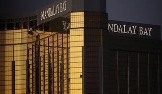 FILE - In this Oct. 3, 2017, file photo, windows are broken at the Mandalay Bay resort and casino in Las Vegas, the room from where Stephen Craig Paddock fired on a nearby music festival, killing 58 and injuring others, on Oct. 1, 2017. A judge in Nevada has approved a total of $800 million in payouts from casino company MGM Resorts International and its insurers to more than 4,400 relatives and victims of the Las Vegas Strip shooting that was the deadliest in recent U.S. history. (AP Photo/John Locher, File)
