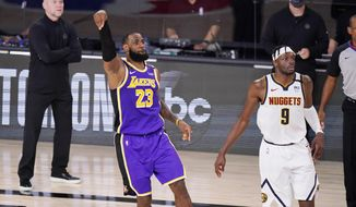 Los Angeles Lakers' LeBron James (23) watches his shot along with Denver Nuggets' Jerami Grant (9) during the second half of an NBA conference final playoff basketball game Saturday, Sept. 26, 2020, in Lake Buena Vista, Fla. The Lakers won 117-107 to win the series 4-1. (AP Photo/Mark J. Terrill)