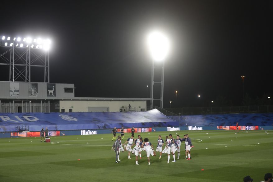 Real Madrid's players warm up prior to the Spanish La Liga soccer match between Real Madrid and Valladolid at Alfredo di Stefano stadium in Madrid, Spain, Wednesday, Sept. 30, 2020. (AP Photo/Manu Fernandez)
