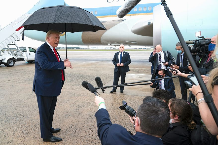 President Trump faces reporters after a recent arrival at Andrews Air Force Base, just outside the nation's capital. (Associated Press)