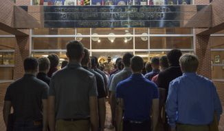 Recruits with Delta Company, 1st Recruit Training Battalion, and Oscar Company, 4th Recruit Training Battalion, wait to pass through the silver hatches at the Marine Corps Recruit Depot Parris Island, S.C., June 24, 2019. The silver hatches symbolize the transformation from a civilian to a recruit.  (U.S. Marine Corps photo by Lance Cpl. Samuel C. Fletcher)