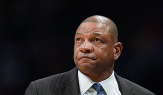 In this Jan. 12, 2020, file photo, Los Angeles Clippers coach Doc Rivers watches during the second quarter of the team's NBA basketball game against the Denver Nuggets in Denver. The Philadelphia 76ers have reached an agreement with Rivers to become their new coach. Rivers reached a deal Thursday to become the latest coach to try to lead the Sixers to their first NBA championship since 1983, a person with direct knowledge of the negotiations told The Associated Press. The person spoke to the AP on Thursday on condition of anonymity because the Sixers had not formally announced the move. (AP Photo/Jack Dempsey, File)  **FILE**