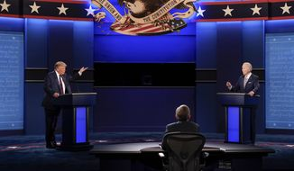 President Donald Trump, left, and Democratic presidential candidate former Vice President Joe Biden, right, during the first presidential debate Tuesday, Sept. 29, 2020, at Case Western University and Cleveland Clinic, in Cleveland, Ohio. Seated in the center is moderator Chris Wallace of Fox News. (AP Photo/Patrick Semansky)