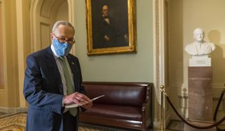 Senate Minority Leader Chuck Schumer of N.Y. walks outside the Senate floor on Capitol Hill, Thursday, Oct. 1, 2020, in Washington. (AP Photo/Manuel Balce Ceneta)