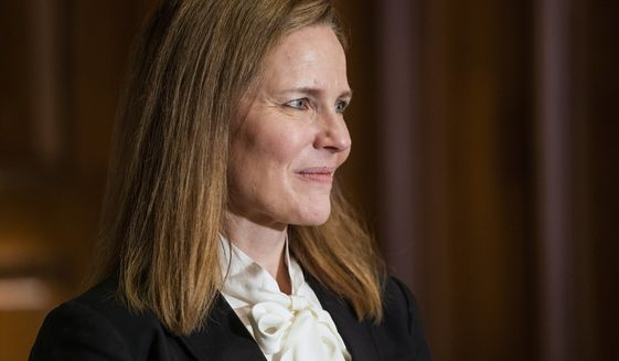 Judge Amy Coney Barrett, President Donald Trumps nominee for the U.S. Supreme Court, meets with Sen. Bill Cassidy, R-La., on Capitol Hill in Washington, Thursday, Oct. 1, 2020. (Jim Lo Scalzo/Pool via AP)