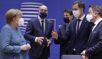 German Chancellor Angela Merkel, left, speaks with from right, Luxembourg's Prime Minister Xavier Bettel, Belgium's new Prime Minister Alexander De Croo, Italy's Prime Minister Giuseppe Conte and European Council President Charles Michel during a round table meeting at an EU summit at the European Council building in Brussels, Thursday, Oct. 1, 2020. European Union leaders are meeting to address a series of foreign affairs issues ranging from Belarus to Turkey and tensions in the eastern Mediterranean. (Olivier Hoslet, Pool via AP)