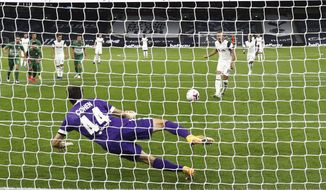 Tottenham's Harry Kane shoots to score a penalty kick during a Europa League soccer match between Tottenham Hotspur and Maccabi Haifa in London, Thursday, Oct. 1, 2020. (Clive Rose/Pool via AP)