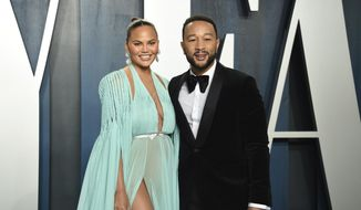 """This Feb. 9, 2020, file photo, Chrissy Teigen, left, and John Legend arrive at the Vanity Fair Oscar Party in Beverly Hills, Calif. Teigen and Legend have revealed the """"deep pain"""" they are feeling, over the loss of their unborn baby following pregnancy complications. Teigen announced their loss on her social media accounts early Thursday, Sept. 30, saying they were """"driving home from the hospital with no baby. This is unreal."""" (Photo by Evan Agostini/Invision/AP, File)"""
