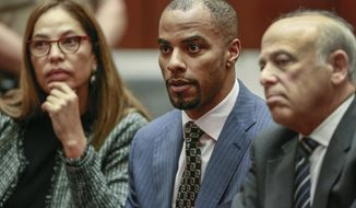 """FILE - In this March 23, 2015, file photo, former NFL football safety Darren Sharper, center, is flanked by his attorneys, Lisa Wayne, left, and Leonard Levine, right, in Los Angeles Superior Court. Disgraced former NFL star Sharper has lost his latest effort to have his 18-year federal sentence tossed out in a drug and sexual assault case involving multiple victims. A federal appellate judge in New Orleans on Thursday, Oct. 1, 2020, denied Sharper a """"certificate of appealability."""" The former Saints star went to the appeals court after a judge rejected the claim that he was not adequately advised on the consequences of his 2015 guilty plea. (AP Photo/Nick Ut, Pool, File)"""