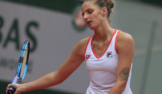 Karolina Pliskova of the Czech Republic reacts after losing a point against Egypt's Mayar Sherif in the first round match of the French Open tennis tournament at the Roland Garros stadium in Paris, France, Tuesday, Sept. 29, 2020. (AP Photo/Michel Euler)