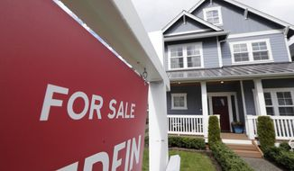 "FILE - In this April 1, 2020 photo, a ""For Sale"" sign stands in front of a home that is in the process of being sold in Monroe, Wash., outside of Seattle.  U.S. average rates on long-term mortgages rose slightly this week but remain at historically low levels. Mortgage buyer Freddie Mac reported Thursday, Sept. 24,  that the average rate on the 30-year home loan edged up to 2.90% from 2.87% last week.   (AP Photo/Elaine Thompson, File)"