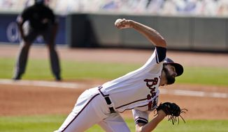 Atlanta Braves starting pitcher Ian Anderson throws against the Cincinnati Reds in Game 2 of a National League wild-card baseball series, Thursday, Oct. 1, 2020, in Atlanta. (AP Photo/John Bazemore)