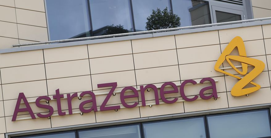 FILE - This Saturday, July 18, 2020 file photo shows a general view of AstraZeneca offices and the corporate logo in Cambridge, England. In a statement on Thursday Oct. 1, 2020, the European Medicines Agency has begun its first review process for the experimental COVID-19 vaccine being developed by Oxford University and AstraZeneca. (AP Photo/Alastair Grant, file)