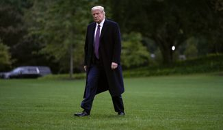 In this Thursday, Oct. 1, 2020, photo, President Donald Trump walks from Marine One to the White House in Washington as he returns from Bedminster, N.J. On Friday, Oct. 2, 2020, (AP Photo/Carolyn Kaster) **FILE**