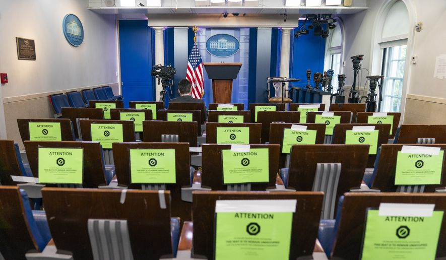 The White House's Brady press briefing room is almost empty, Friday, Oct. 2, 2020, in Washington. (AP Photo/Manuel Balce Ceneta)