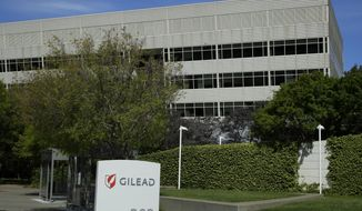 """FILE - This April 30, 2020, file photo shows Gilead Sciences headquarters in Foster City, Calif. The European Medicines Agency says it has started a safety review after some patients taking the coronavirus drug remdesivir reported serious kidney problems. In a statement on Friday, Oct. 2, 2020, the EU regulator said it isn't clear whether remdesivir is causing the """"acute kidney injury,"""" but that the issue """"warrants further investigation."""" Remdesivir is one of the few licensed treatments for the coronavirus, in additional to the generic steroid dexamethasone. In July, health experts criticized the U.S. for buying up a significant portion of the drug, made by Gilead Sciences. (AP Photo/Ben Margot, File)"""