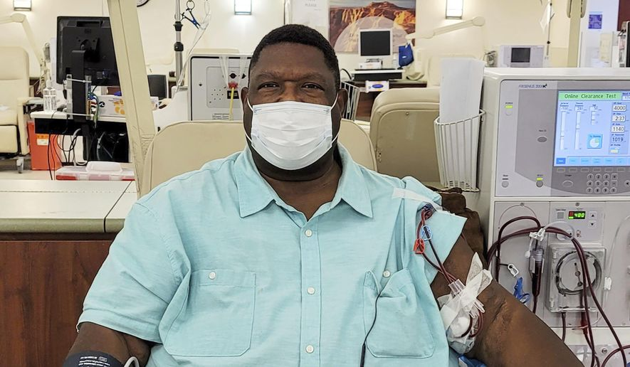 In this remotely-controlled selfie provided by DeWayne Cox, Cox, who opposes Proposition 23, undergoes kidney dialysis treatment at a clinic in Los Angeles on Sept. 9, 2020. In November, California voters will again weigh the quality of care dialysis clinics provide to about 80,000 people in the state with kidney failure. Proposition 23 would require a doctor or highly trained nurse at each of the state's 600 dialysis clinics whenever patients are being treated to improve patient care. It was placed on the ballot by unions that represent health care workers. (DeWayne Cox via AP)