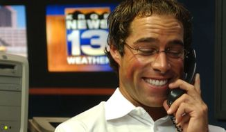 FILE - In this Oct. 5, 2006, photo, KRQE-TV meteorologist Mark Ronchetti prepares the weathercast at the KRQE studios in Albuquerque, N.M. Rep. Ben Ray Lujan, D-N.M., is vastly outspending well-known Republican former television meteorologist Ronchetti, a first-time political candidate with a tough-on-crime message, in the race to succeed retiring Sen. Tom Udall. (Jaelyn deMaria/The Albuquerque Journal via AP, File)