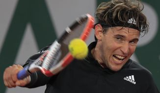 Austria's Dominic Thiem plays a shot against Norway's Casper Ruud in the third round match of the French Open tennis tournament at the Roland Garros stadium in Paris, France, Friday, Oct. 2, 2020. (AP Photo/Michel Euler)