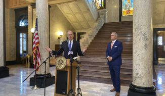 Mississippi Lieutenant Gov. Delbert Hosemann announces the end of the Legislative session at the Mississippi state Capitol building on Friday, Oct. 2, 2020, in Jackson, Miss., as House Speaker Philip Gunn stands beside him.  (AP Photo/Leah Willingham)