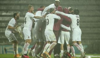 Milan players celebrate after winning the Europa League playoff soccer match between Rio Ave FC and AC Milan in Vila do Conde, Portugal, Thursday, Oct. 1, 2020. Milan won a penalty shootout 9-8 after the match ended tied 2-2. (AP Photo/Luis Vieira)