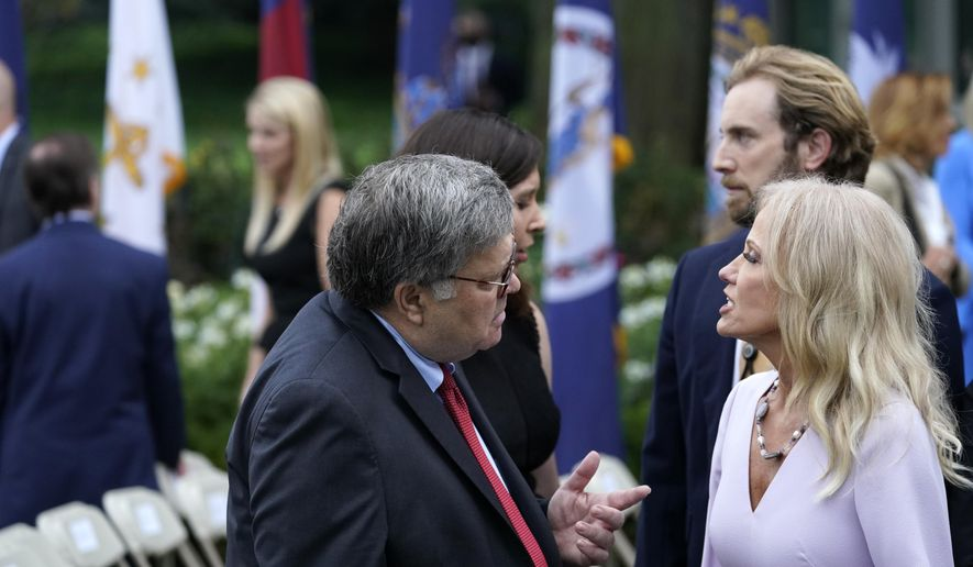 Attorney General William Barr speaks with Kellyanne Conway after President Donald Trump announced Judge Amy Coney Barrett as his nominee to the Supreme Court, in the Rose Garden at the White House, Saturday, Sept. 26, 2020, in Washington. (AP Photo/Alex Brandon)