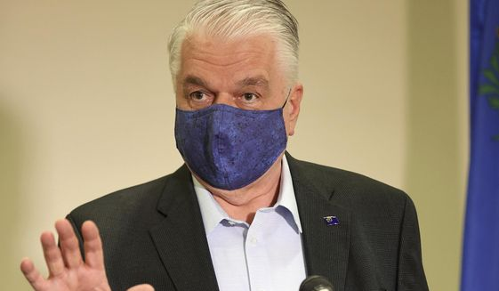 In this file photo, Nevada Gov. Steve Sisolak updates the state's COVID-19 response efforts and lifting of restrictions on youth and adult recreation sports during a news conference at the Sawyer Building in Las Vegas, Friday, Oct. 2, 2020. (K.M. Cannon/Las Vegas Review-Journal via AP, Pool)  **FILE**