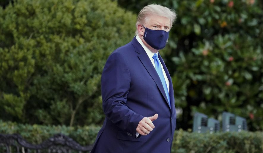 President Donald Trump leaves the White House to go to Walter Reed National Military Medical Center after he tested positive for COVID-19, Friday, Oct. 2, 2020, in Washington. (AP Photo/Alex Brandon)