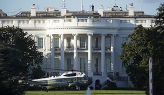 """The helicopter that will carry President Donald Trump to Walter Reed National Military Medical Center in Bethesda, Md., lands on the South Lawn of White House in Washington, Friday, Oct. 2, 2020. The White House says Trump will spend a """"few days"""" at the military hospital after contracting COVID-19. (AP Photo/J. Scott Applewhite)"""