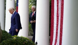 President Donald Trump arrives with Vice President Mike Pence to speak about coronavirus testing during an event in the Rose Garden of the White House, Monday, Sept. 28, 2020, in Washington. (AP Photo/Evan Vucci) **FILE**