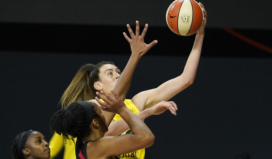 Seattle Storm forward Breanna Stewart (30) shoots over Las Vegas Aces guard Jackie Young and center A'ja Wilson during the second half of Game 1 of basketball's WNBA Finals Friday, Oct. 2, 2020, in Bradenton, Fla. (AP Photo/Chris O'Meara)