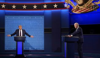 President Donald Trump, left, reacts as former Vice President Joe Biden speaks during the first presidential debate Tuesday, Sept. 29, 2020, at Case Western University and Cleveland Clinic, in Cleveland, Ohio. (AP Photo/Julio Cortez)