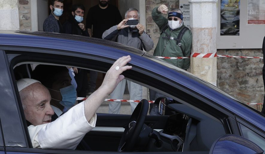 Pope Francis leaves the St. Francis Basilica after signing a new encyclical on fraternity and solidarity in the post-COVID world, in Assisi, Italy, Saturday, Oct. 3, 2020. (AP Photo/Gregorio Borgia)
