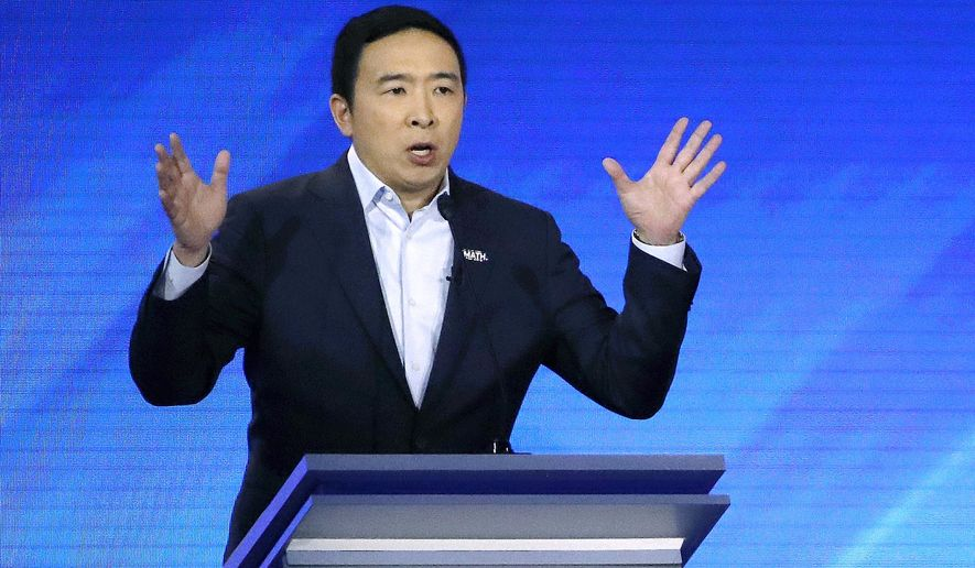 In this Feb. 7, 2020 file photo, then-Democratic presidential candidate entrepreneur Andrew Yang speaks during a Democratic presidential primary debate at Saint Anselm College in Manchester, N.H. (AP Photo/Elise Amendola, File)