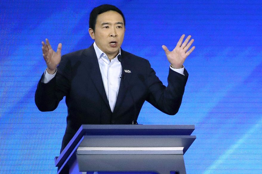 Then-Democratic presidential candidate entrepreneur Andrew Yang speaks during a Democratic presidential primary debate at Saint Anselm College in Manchester, New Hampshire, Feb. 7, 2020. (AP Photo/Elise Amendola) ** FILE **