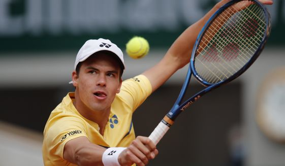 Germany's Daniel Altmaier plays a shot against Italy's Matteo Berrettini in the third round match of the French Open tennis tournament at the Roland Garros stadium in Paris, France, Saturday, Oct. 3, 2020. (AP Photo/Christophe Ena)
