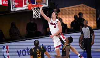 Miami Heat forward Kelly Olynyk (9) takes a shot over Los Angeles Lakers' Anthony Davis (3) and Kentavious Caldwell-Pope, right, during the second half of Game 2 of basketball's NBA Finals, Friday, Oct. 2, 2020, in Lake Buena Vista, Fla. (AP Photo/Mark J. Terrill)
