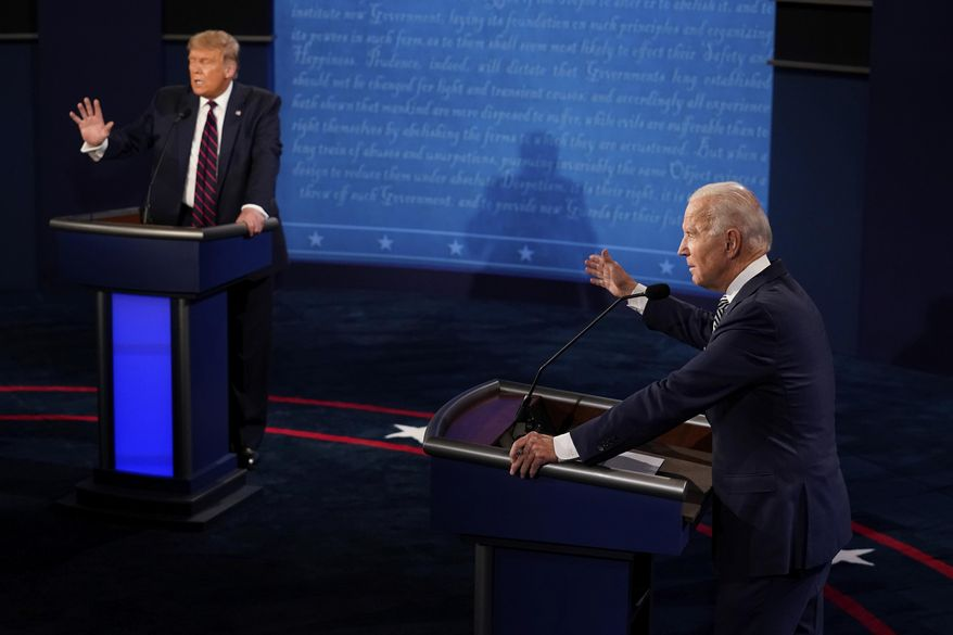President Donald Trump and Democratic presidential candidate former Vice President Joe Biden exchange points during their first presidential debate Tuesday, Sept. 29, 2020, at Case Western University and Cleveland Clinic, in Cleveland, Ohio. (AP Photo/Morry Gash, Pool)