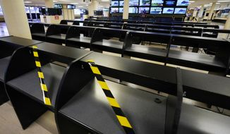 Betting tables are empty at Pimlico race track, Friday, Oct. 2, 2020, in Baltimore, Md., ahead Saturday's Black-Eyed Susan and Preakness Stakes races. (AP Photo/Steve Helber)
