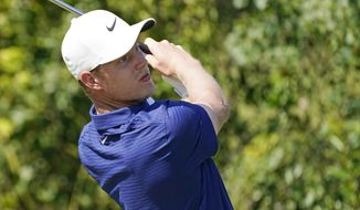 Cameron Davis, of Australia, watches his drive from the 10th tee during the third round of the Sanderson Farms Championship golf tournament in Jackson, Miss., Saturday, Oct. 3, 2020. (AP Photo/Rogelio V. Solis)