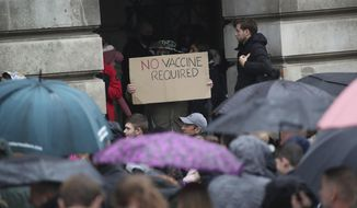 A protester holds a sign at an anti coronavirus  lockdown protest in Old Market Square, Nottingham, England, after a range of new restrictions to combat the rise in coronavirus cases came into place in England,  Saturday, Oct. 3, 2020. (Danny Lawson/PA via AP)