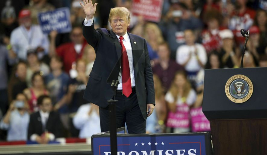 President Donald Trump waves to the crowd after speaking at a campaign rally, Wednesday, June 20, 2018, in Duluth, Minn. (AP Photo/Jim Mone File)