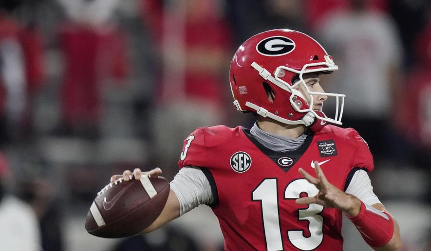 Georgia quarterback Stetson Bennett looks for a receiver during the second half of the team's NCAA college football game against Auburn, Saturday, Oct. 3, 2020, in Athens, Ga. (AP Photo/Brynn Anderson)