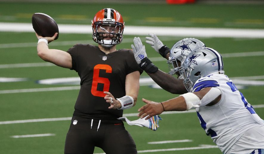 Cleveland Browns quarterback Baker Mayfield (6) throws a pass under pressure from the Dallas Cowboys defense in the first half of an NFL football game in Arlington, Texas, Sunday, Oct. 4, 2020. (AP Photo/Michael Ainsworth)