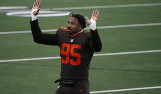Cleveland Browns defensive end Myles Garrett (95) waves to fans after their 49-38 win against the Dallas Cowboys in an NFL football game in Arlington, Texas, Sunday, Oct. 4, 2020. (AP Photo/Michael Ainsworth)