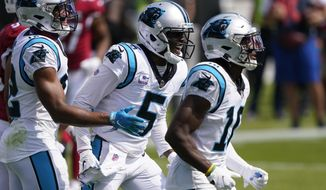 Carolina Panthers quarterback Teddy Bridgewater (5) celebrates after scoring against the Arizona Cardinals during the first half of an NFL football game Sunday, Oct. 4, 2020, in Charlotte, N.C. (AP Photo/Brian Blanco)